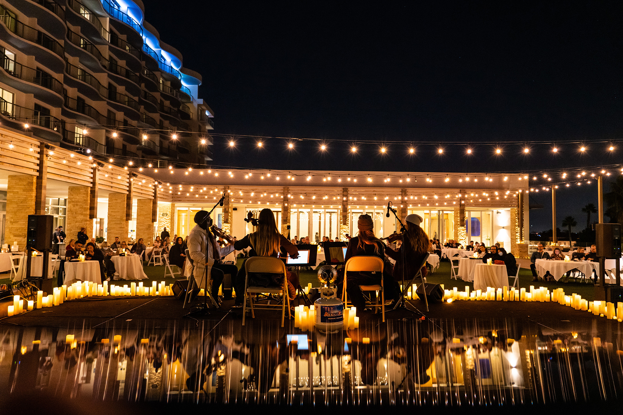 A Glittering Oasis Awaits You This Summer At This Poolside Candlelight Concert Series